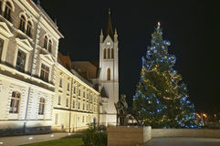Christmas tree with church tower black sky Stock Photos