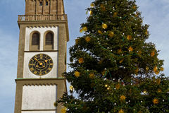 Christmas tree at church tower. Decorated Christmas tree erected at the Perlachturm tower of Augsburg, Germany. Christian tradition Royalty Free Stock Images