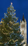 Christmas tree and church tower tele Stock Photo