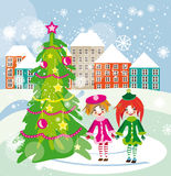 Christmas tree on the city square with two little  Stock Images