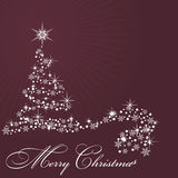 By Christmas tree on claret background Royalty Free Stock Images