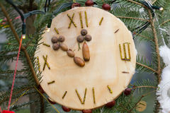 Christmas tree. A clock decorate the Christmas tree Royalty Free Stock Images