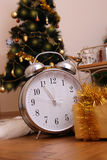 Christmas tree with clock on twelve and gifts Royalty Free Stock Photo