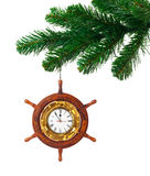 Christmas tree and clock in wood helm Stock Images