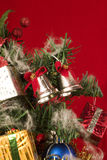 Christmas Tree - close up. Christmas tree with baubles and star ornaments and gifts Stock Images