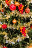 Christmas Tree. Close up of a christmas tree decorated with golden tinsel and gold tinged orbs Stock Images