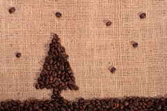 Christmas tree from coffee beans with stars Royalty Free Stock Photo