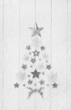 Christmas tree of a collection with white, silver and grey stars Royalty Free Stock Photos
