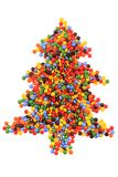 Christmas tree from color smarties isolated. On the white background Stock Photography