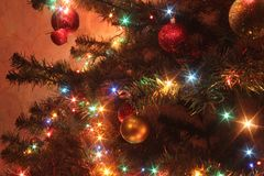 Christmas tree with colored lights stock images