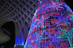 Christmas tree with colored lights, Seville, Spain. Christmas tree lit at night placed in the Metropol building, popularly known as Mushrooms (Las Setas) Royalty Free Stock Photography
