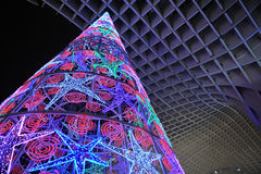 Christmas tree with colored lights, Seville, Spain. Christmas tree lit at night placed in the Metropol building, popularly known as Mushrooms (Las Setas) Royalty Free Stock Photos