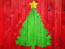 Christmas Tree on Colored Wood Stock Photography