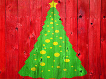 Christmas Tree on Colored Wood Stock Image