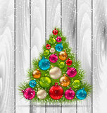 Christmas Tree and Colorful Balls on Wooden Royalty Free Stock Image