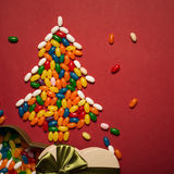 Christmas tree from colorful candies and gift box Royalty Free Stock Photography