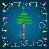 Christmas tree with colorful garland Stock Image