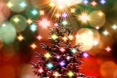 Christmas tree on colorful lights background stock photography