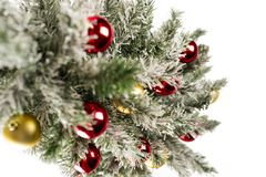 Christmas tree with colorful ornaments. Isolated on white royalty free stock photo