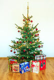 Christmas tree with colorful ornaments stock photos