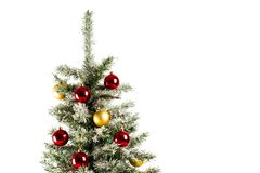 Christmas tree with colorful ornaments. Isolated on white stock photography