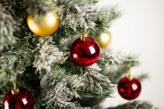 Christmas tree with colorful ornaments. Isolated on white stock images