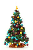 Christmas tree with colorful ornaments. Studio shot of a Christmas tree with colorful ornaments, isolated on a white background Royalty Free Stock Photos