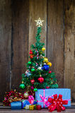 Christmas tree with colorful ornaments a wood background Stock Photos