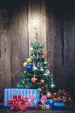 Christmas tree with colorful ornaments a wood background.  royalty free stock photos