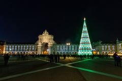 Christmas tree on Commerce square. At night in Lisbon, Portugal stock images