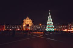 Christmas tree on Commerce square. At night in Lisbon, Portugal stock photos