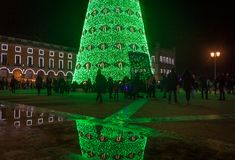 Christmas tree on Commerce square. At night in Lisbon, Portugal royalty free stock photo