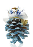 Christmas tree cones and bell on white background Stock Photography