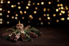 Christmas tree and cones decorated with burning candle and boke. Christmas holiday celebration. Concept stock photo