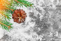 Christmas tree and cones on the old wooden table. Picturesque winter composition. Royalty Free Stock Photography
