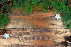 Christmas tree, cones, stars on wooden background. Christmas bac Royalty Free Stock Photo