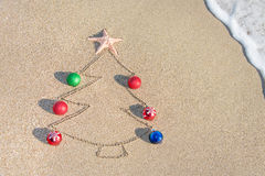 Christmas tree contour with decorations, star and wave Stock Image