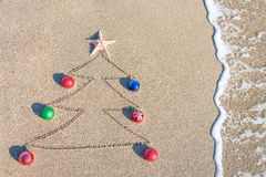 Christmas tree contour with decorations, star and wave Royalty Free Stock Photo