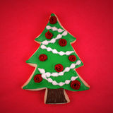 Christmas Tree Cookie. On red royalty free stock photo