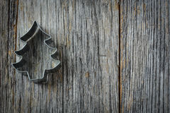 Christmas Tree Cookie Cutter on Rustic Wood Royalty Free Stock Images