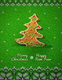 Christmas tree cookie on knitted background Royalty Free Stock Photo