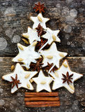 Christmas tree cookie with spices on the old wooden background Royalty Free Stock Images