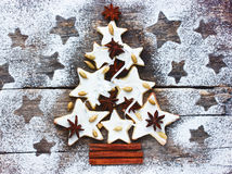 Christmas tree cookie with spices on the old wooden background Royalty Free Stock Image