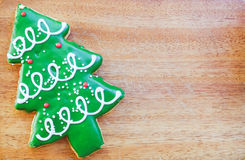 Christmas tree cookie on wood background. Stock Photography