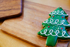 Christmas tree cookie on wood plate. Cookies decorated for Christmas theme placing on wood board Royalty Free Stock Image