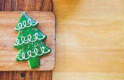 Christmas tree cookie on wood plate. Stock Image