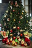 Christmas tree with cookies, cupcakes, balls, sweets, candy, ornaments. For the celebration royalty free stock photo
