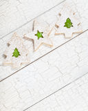Christmas Tree cookies. Overhead view of 3 Christmas linzer cookies with green jelly aranged diagonally on white painted background. Copy Space stock images