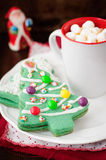 Christmas Tree Cookies on a White Plate with a Cup of Coffee or Royalty Free Stock Photo