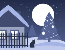 Christmas tree and cottage Royalty Free Stock Photography